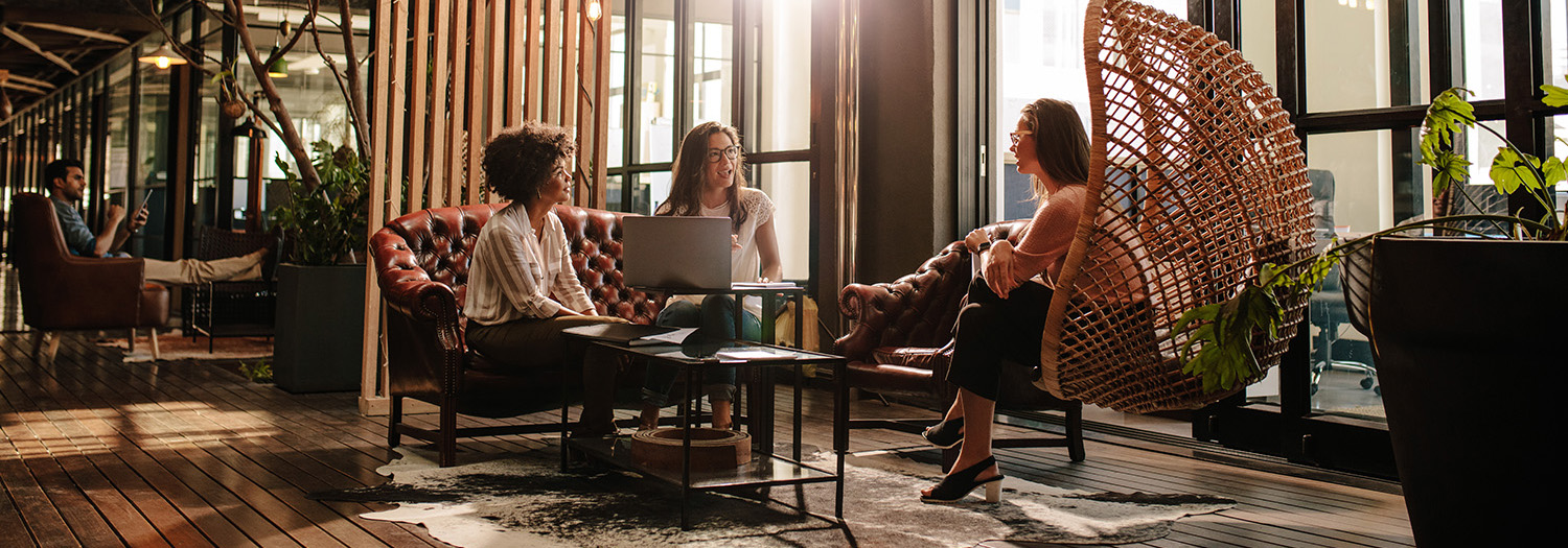 Business women working in a lounge area